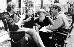 "Director Peter Weir with actors Kelly McGillis, Jan Rubes and Harrison Ford on the set of ""Witness"""