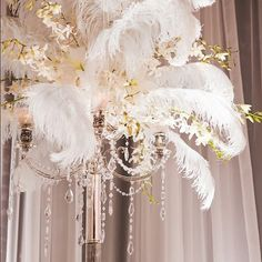 Design Tip! Spice up an ostrich feather centerpiece with silk floral sprays and crystal garlands! Web Instagram User » Followgram