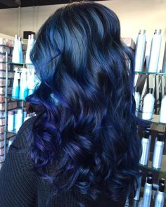 Long Black Hair With Blue Highlights.  Have a little fun and try an ombre style that combines a brighter blue with a darker, purple-tinted blue.