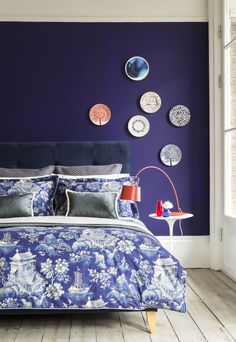 Love the rich blues in this bedroom featuring our Iris Bedstead