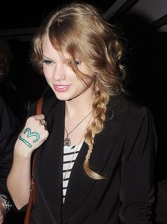 I love how Tay always has the number 13 on her arm during a concert <3