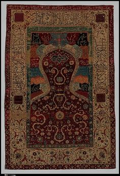 Carpet from Iran, in the 16th century. Made of silk, wool, and metal wrapped thread. 161.3x109.9cm. This textile has thick borders as influence from Persian textiles, with curvilinear and interactive motifs. The overall design of this piece is very dense and complex with vines etc. Colors are not as bold as seen in Caucasus textiles. One key indicator of Persian influences is the use of calligraphy.
