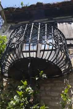 a cast iron balcony on an old french building