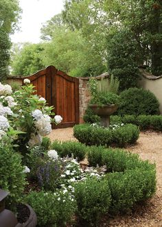 Love the wood gates with the meandering but somewhat formal hedge plantings.