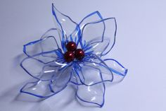 Floral Craft - Recycled plastic flower made from plastic beverage bottles.