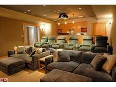 A very cozy home theater. Love the sitting arrangement. For I would dark colors.