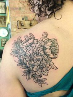 Floral back tattoo-such a refreshing style for flowers :)