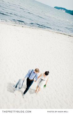 Sweet wedding photograph. Bride and groom on the beach.