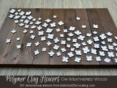Dimensional artwork -- Polymer clay flowers on weathered wood from Addicted 2 Decorating