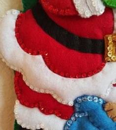 Hes making a list... checking it twice! This handmade felt stocking features Santa Claus, getting ready to deliver Christmas gifts to all of the good boys and girls. Helping Santa is a happy snowman, hoping his name is on the list, too!   Stocking measures 18 inches, and is lightly stuffed for added dimension.   Personalization is optional, and free of charge. *For personalization, please add the name in a comment when you place your order.*  Made in a smoke-free, pet free home. Thank you…