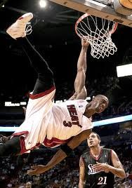 Dwyane Wade of the Miami Heat hangs on to the rim after being fouled trying to dunk in the second half against the Philadelphia at American. Stock Pictures, Stock Photos, Dwyane Wade, Slam Dunk, Miami Heat, Nba, Two By Two, American, Concert