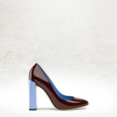 The Fendi Fall/Winter 2014-15 burgundy Eloise patent leather pump with contrasting sky blue stack heel. For more Fendi must-haves, visit http://balharbourshops.com/