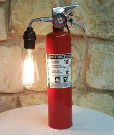 When looking for a lamp for your house, the choices are nearly limitless. Find the perfect living room lamp, bedroom lamp, table lamp or any other type for your specific room. Lampe Tube, Firefighter Decor, Make A Lamp, Bright Homes, Pipe Lamp, Bedroom Lamps, Fire Extinguisher, Lamp Design, Lamp Light