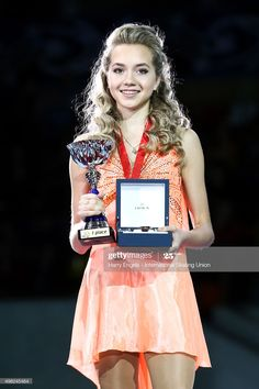 Gold medalist Elena Radionova of Russia poses with her medal on day three of the Rostelecom Cup ISU Grand Prix of Figure Skating 2015 at the Luzhniki Palace of Sports on November 2015 in Moscow,. Get premium, high resolution news photos at Getty Images Elena Radionova, Kim Yuna, Rostelecom Cup, Figure Ice Skates, Alina Zagitova, World Figure Skating Championships, Ice Skating Dresses, Dance Choreography Videos, Figure Skating