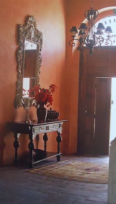 Mexican decor: soft light and spanish entry carved wooden table