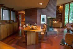 "The built-in dining room table is 'anchored' to the central fireplace mass - Wright's John J. Dobkins House, Canton Illinois - A ""Usonian"" home designed using a triangular grid."