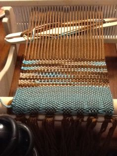 Weaving a scarf on a Cricket rigid heddle loom with the assistance of a weaving class through Craftsy.com.
