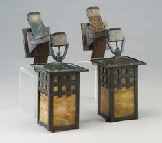 Pair of GUSTAV STICKLEY hammered copper lanterns