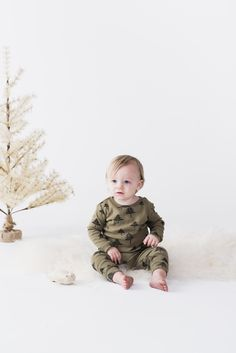 Rylee + Cru Boy Outfit | Tree Pajamas Set | Olive Green colored top & bottom | Top: Full length sleeve with ribbed cut, crew neckline, and long cut torso | Bottom: Fabric covered elastic waistband, ample cut bottom with slight drop crotch, and full length legs to cuffed hems | 100% organic cotton |