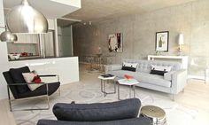 Gus* Modern | The Spencer Sofa shows off his mid-century modern lines in this cool, urban living room space.