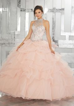 Quinceanera Dresses by Morilee designed by Madeline Gardner. Tulle Quinceañera Dress Featuring a Gorgeous Jewel Beaded Bodice and High Halter Neckline.