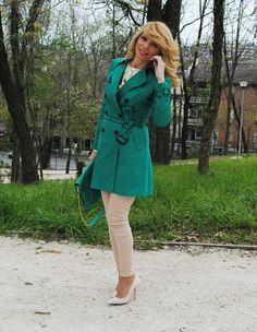 Green trench coat and pastel pink skinnies