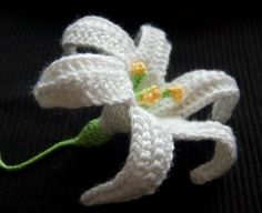 The Easter Lily, aka the November Lily, is a traditional, but real Lilies only last a little while. What to do? Break out the hooks and crochet an Easter Lily!