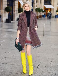 neon yellow boots with tweed coat