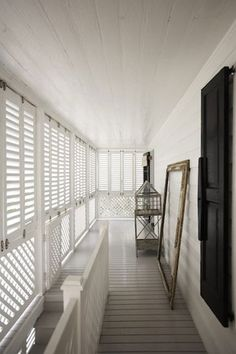 India Hicks - grey floor boards with white shutters Home addition master porch and stairs Porch Lattice, White Shutters, British Colonial Style, Ikea, Queenslander, Grey Flooring, Tropical Houses, Stores, Architecture