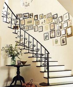 Wall collage for the curved wall by staircase