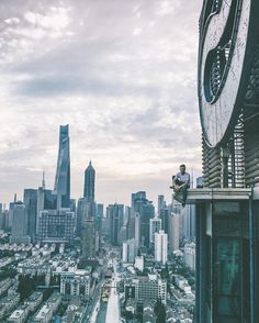 Oliver Shou is a talented young self-taught photographer, roofer and traveler. He captured breathtaking rooftop shorts from skyscrapers of Shanghai.