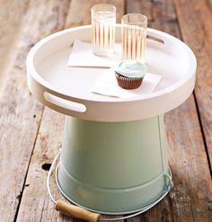 Galvanized Bucket    Use a bucket as an outdoor side table. Top a bucket with a tray for an instant side table for your lawn chairs.