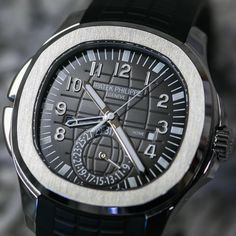 SWISSWATCHES — Patek Philippe Aquanaut 5164A in stainless...