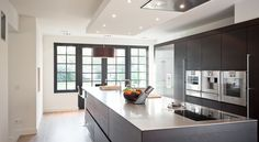 contemporary kitchen in matte black with floor to ceiling storage and built-in appliances  - detweedekamer.com House Design, Kitchen Dining, Interior Deco, Home Kitchens, Home, Interior, Modern Kitchen, Contemporary Kitchen, Room Interior