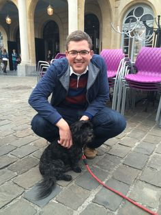 Associate Director for Emmanuel's Center for Mission Engagement Mark Harrington posed with a pup in Namur.