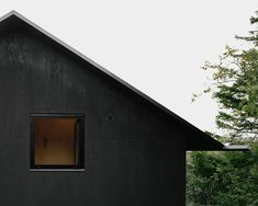 "Striking black house. ""cladded in plywood, coated in black pine tar just like the traditional way of preserving wooden boats."""