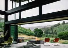 A living room with folding doors leading out onto the patio near Carmel CA [1050739] By Feldman Architecture Photographed by Joe Fletcher (MIC)