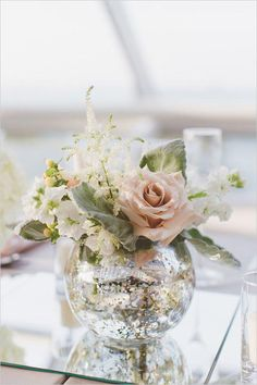 Wedding Flower Arrangements Clear round vase is perfect. More - Ashley and Connor's Modern Peach and Silver Wedding in Chicago is a shinning example of what a wedding under the stars can be. Mercury Glass Centerpiece, Mirror Centerpiece, Glass Centerpieces, Wedding Table Centerpieces, Table Decorations, Mercury Glass Wedding, Graduation Centerpiece, Silver Wedding Decorations, Quinceanera Centerpieces