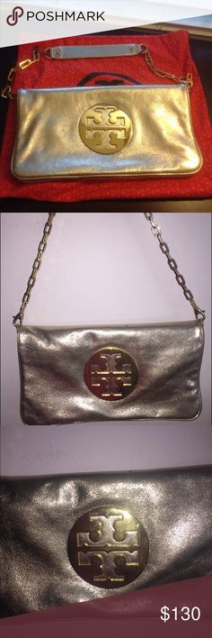 Tory burch Authentic gold tory shoulder bag. Worn but in great condition. Some scratches on the Tory butch symbol.COMES WITH DUST BAG! Tory Burch Bags