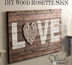 DIY Wood Wall Art with Fabric Rosettes  this would be perfect for over the bed