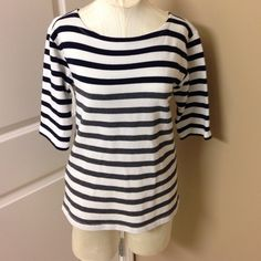 J Crew navy/gray strip top Such a cute top! Navy stripes toward the top and gray stripes halfway down. When I was taking pictures I noticed a couple of stains towards the bottom of the front of the shirt. I haven't tried getting them out but I priced the shirt with this in mind :) J. Crew Tops
