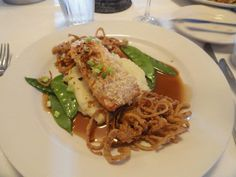 My favorite dish in the state:  Horseradish encrusted Salmon with wasabi mash, snow peas, soy fried shallots and a mirrin-butter sauce.    Sweet baby Jesus.