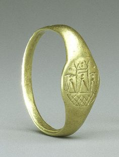 Gold ring with representation of the temple of Aphrodite at Paphos