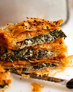 Stack of freshly baked Spanakopita slices Greek Spinach Pie, Spinach And Feta, Greek Recipes, New Recipes, Cooking Recipes, Favorite Recipes, Yummy Recipes, Vegetable Recipes, Vegetarian Recipes