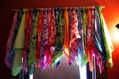 A valance I made for our computer room.  In this one I used colorful bandanas.  I fastened them on with thread.