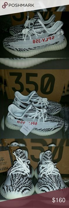 Yeezy 350 V2 ZEBRA -WM Sz 6.5 New Womens Yeezy 350 v2 blk/WHT Zebra colorway New and never worn. These are UA shoes,if you are not sure what that is please ask before purchase.Im here to help. Great quality,soft and comfortable. Come w/Box ,keychain,Adidas bags,and socks. Please view pics ,pics are current.what you see is what you get. NO Returns  Please allow 1-3 days to ship.  Thanks for browsing. Adidas Shoes Athletic Shoes