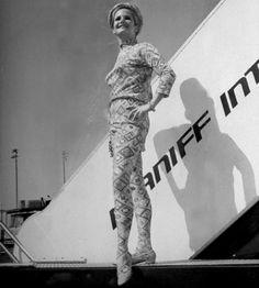 Braniff stewardess models new uniform. Flight Attendant, Sirens, Sky, Statue, Models, History, Life, Heaven, Templates