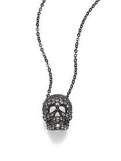 A touch of sparkle adds glam to this skull necklace from Adriana Orsini.