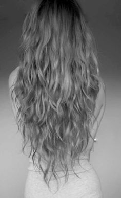 v cut with long layers on naturally wavy hair