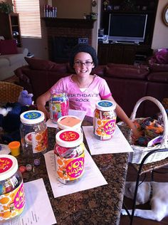 """Jessie Rees prepares JoyJars to take to sick children in the hospital.  Even while she was very ill, Jessie asked about about children with cancer: """"What can we do for them?""""  She made JoyJars!"""